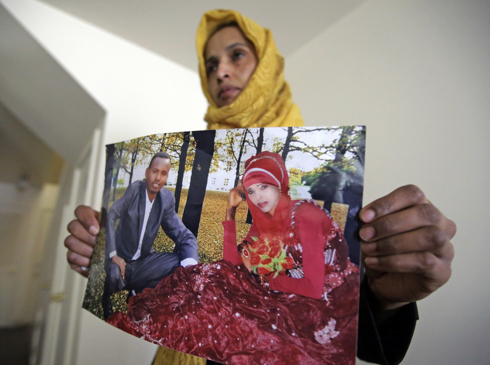 Somali refugee Nimo Hashi, who lives in Salt Lake City, holds a photo of her husband – one of the hundreds of people left in limbo by a ban on travelers from Somalia and six other Muslim-majority countries. President Trump says the order is aimed at protecting Americans from terrorists, even though no fatal attack has been linked to immigrants from the seven targeted nations.