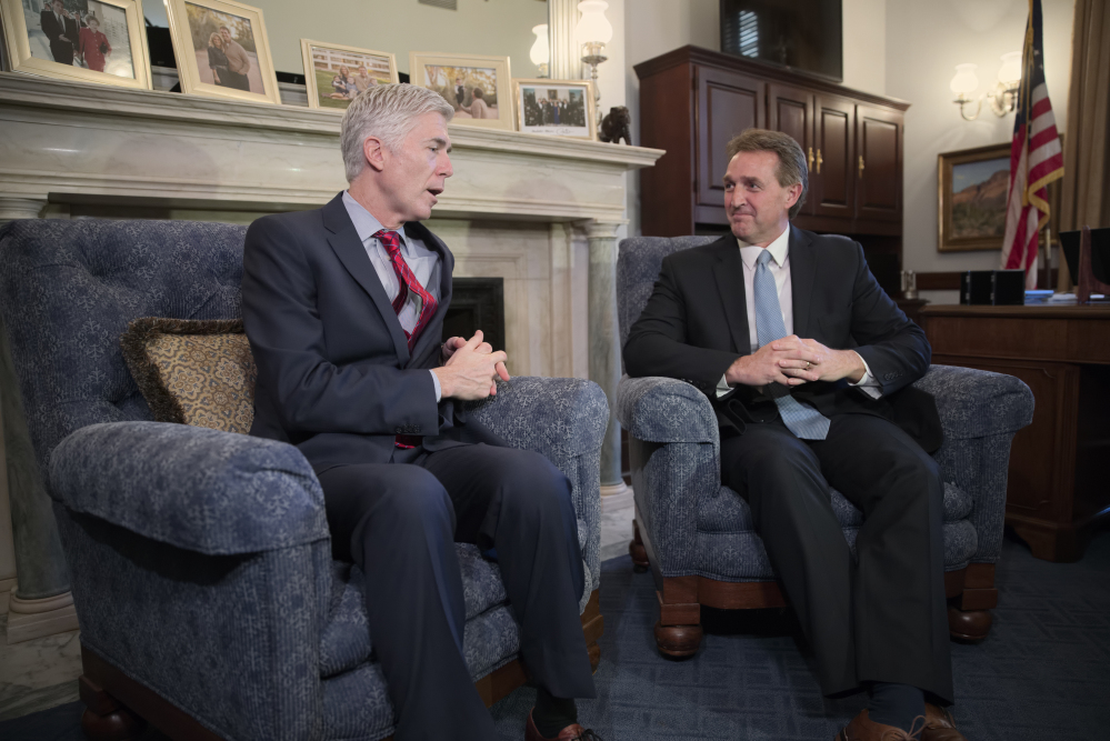 "Supreme Court justice nominee Neil Gorsuch meets with Senate Judiciary Committee member Jeff Flake, R-Ariz., on Wednesday on Capitol Hill. Gorsuch told lawmakers that President Trump's attacks on the judiciary are ""disheartening"" to the independence of the federal courts."
