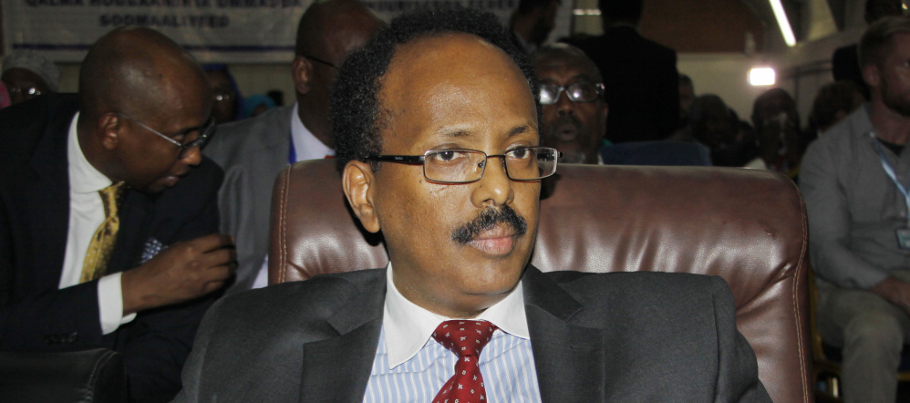 "Mohamed Abdullahi Farmajo sits in the election hall in Mogadishu after being declared president of Somalia on Wednesday. ""This is the beginning of the era of unity, the democracy of Somalia and the beginning of the fight against corruption,"" he said after taking the oath of office."