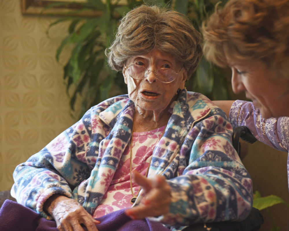 Adele Dunlap, then 113, talks with Susan Dempster, the activities director at the Country Arch Care Center in Pittstown, N.J., in 2016. Dunlap died Sunday at age 114.