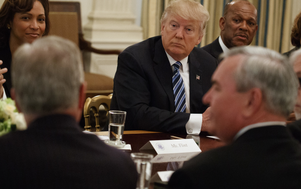 "President Trump listens Thursday during a meeting with airline and airport executives at the White House. Trump, who once ran his own airline, pledged to help the companies deliver ""the greatest service"" with minimum delays and at the lowest cost in modernized facilities."