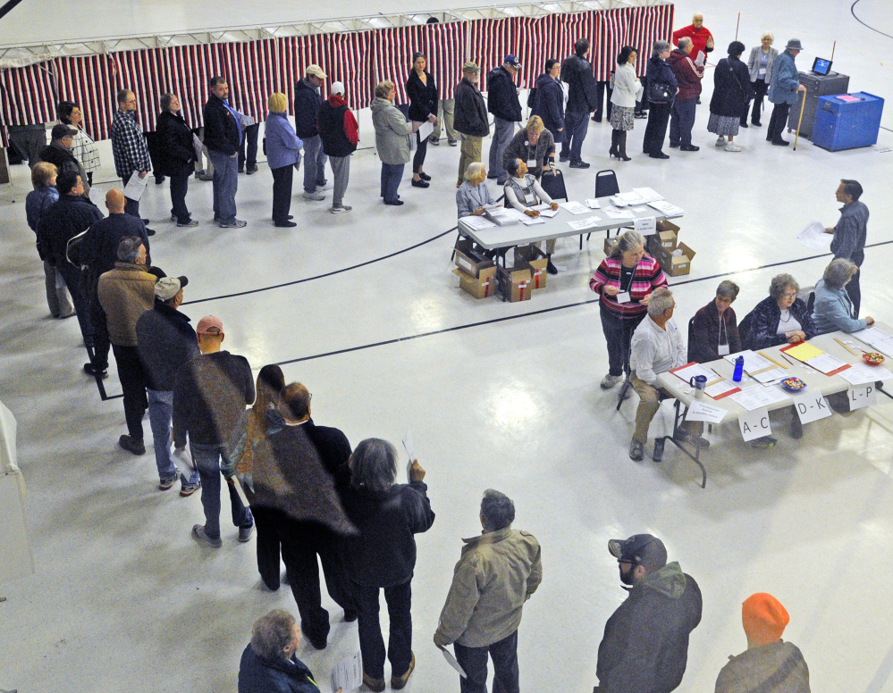 Voters wait to cast ballots in Augusta on Election Day, 2016. Efforts are underway in Maine and other states to adopt or tighten requirement to show identification at the polls.