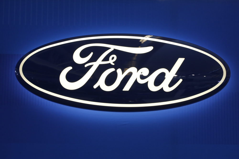 Ford Motor will spend $1 billion to take over a robotics startup as it works toward developing a fully driverless vehicle by 2021.