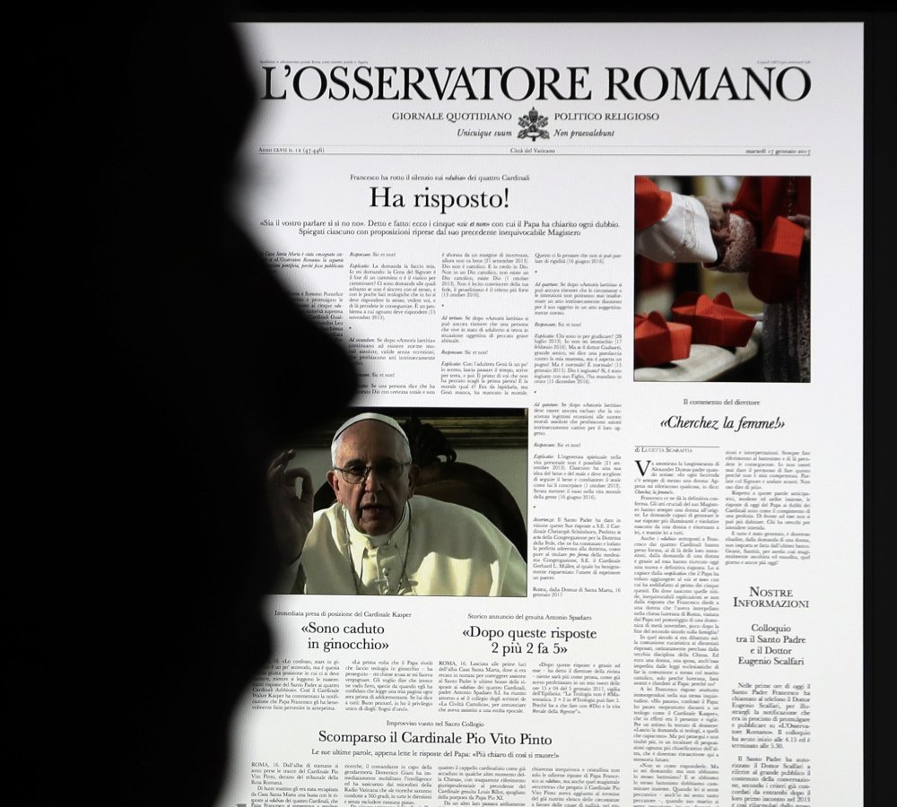 "A fake copy of the Vatican newspaper L'Osservatore Romano, with the headline reading ""He responded!"", is shown in Rome."