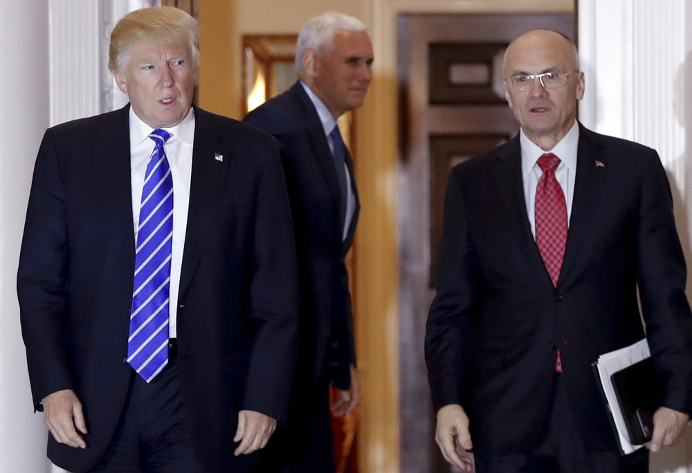 Then-President-elect Trump accompanies Labor Secretary-designate Andrew Puzder on Nov. 19.