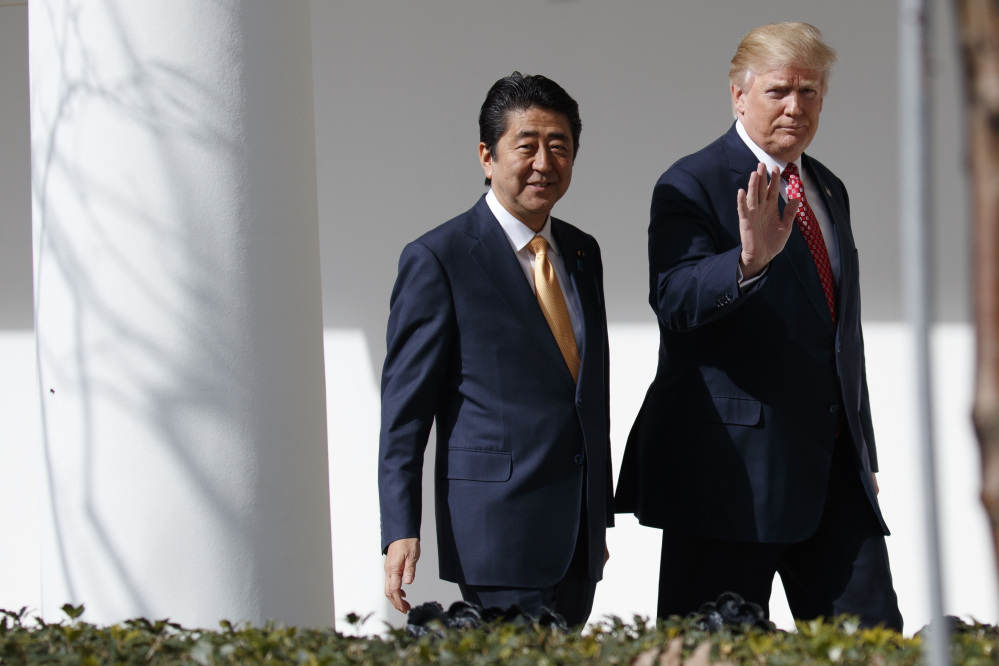 President Trump walks with Japanese Prime Minister Shinzo Abe to a news conference at the White House in Washington on Friday.