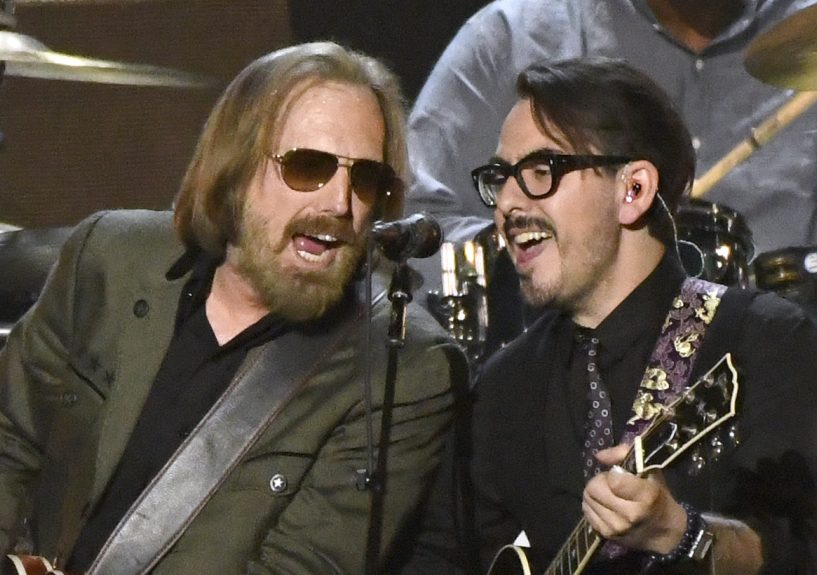 Tom Petty and Dhani Harrison, son of the late Beatle, perform Friday at a benefit in Los Angeles.