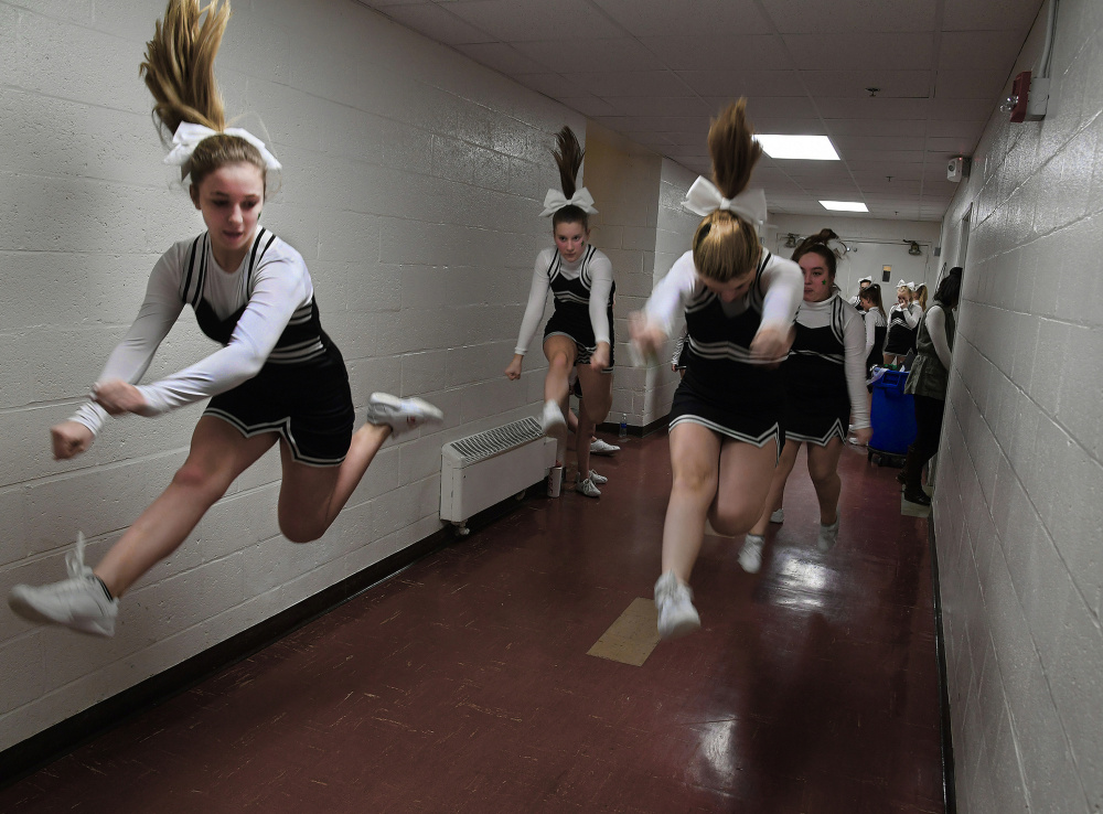 Members of the East Millinocket-Medway Competition Cheer Squad warm up in a Schenck High School hallway before a basketball game. Rural schools like Schenck are wondering how – and whether – they'll survive under a federal Education Department focused on school choice.