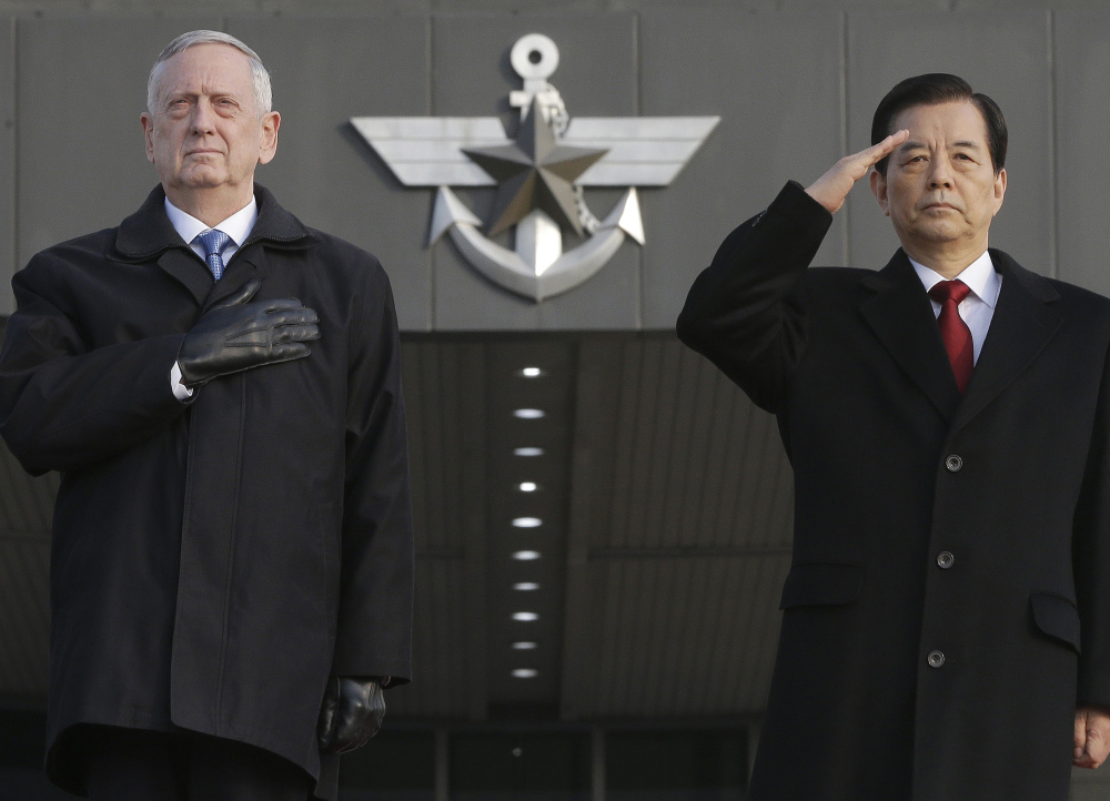 Defense Secretary Jim Mattis and South Korean Defense Minister Han Min Koo salute during a welcome ceremony for Mattis at the Defense Ministry in Seoul, South Korea, on Feb. 3. On Tuesday, Mattis plans to head to Europe as he works to develop a strategy dealing with terrorism. Associated Press/Ahn Young-joon