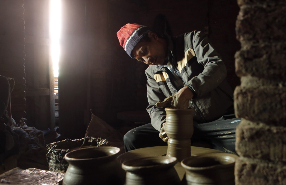 "Dil Krishna Prajapati, 54, moulds a clay pot in Thimi. ""Times have changed, new products have flooded the market, and people from potter caste love other lucrative professions. I fear that the tradition will fade away,"" says Dil Krishna."