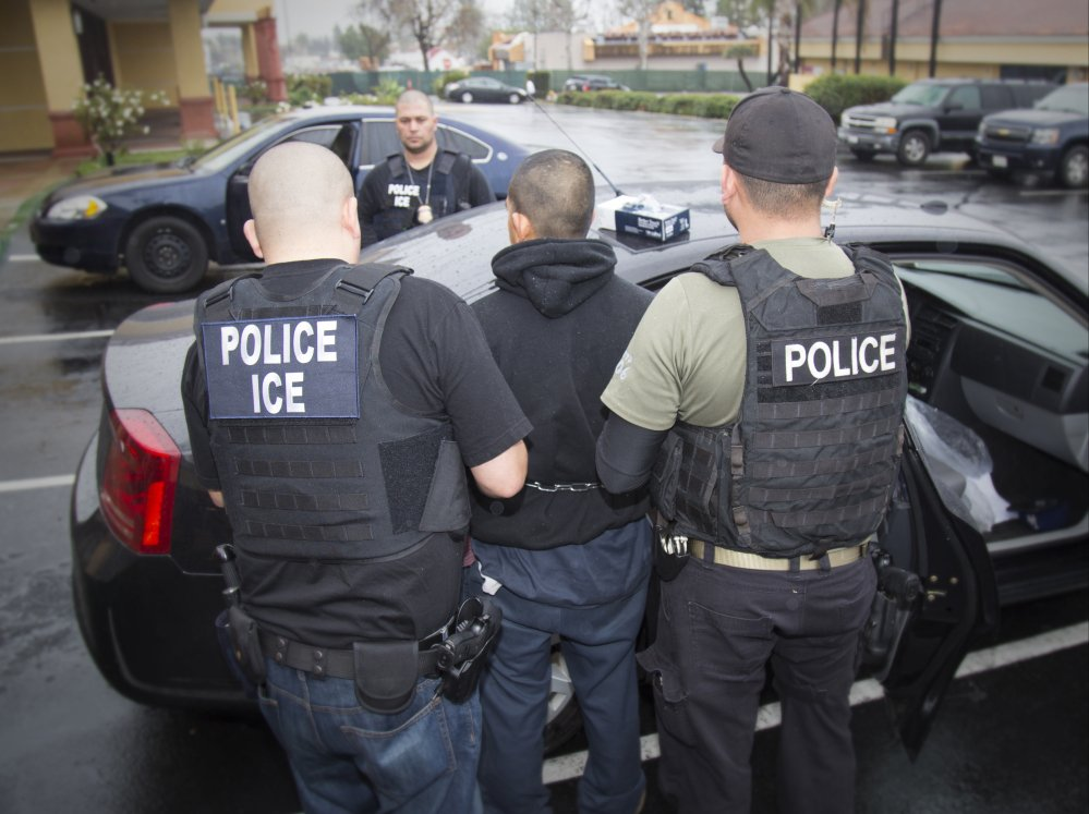Foreign nationals are shown being arrested Tuesday during a targeted enforcement operation conducted by U.S. Immigration and Customs Enforcement in Los Angeles.