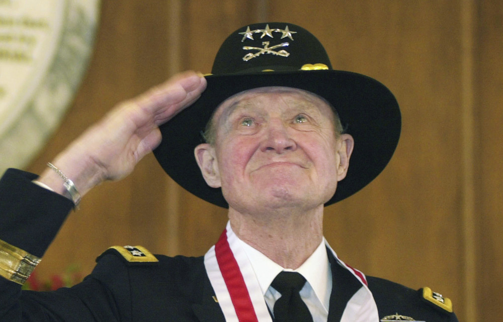 Retired Lt. Gen. Hal Moore salutes the crowd during a standing ovation at the Spirit of Alabama Awards in Montgomery, Ala., in 2004.