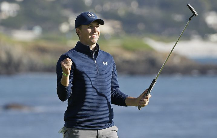 Jordan Spieth celebrates on the 18th green at Pebble Beach after winning the AT&T Pebble Beach National Pro-Am on Sunday. Spieth finished four shots ahead of Kelly Kraft.