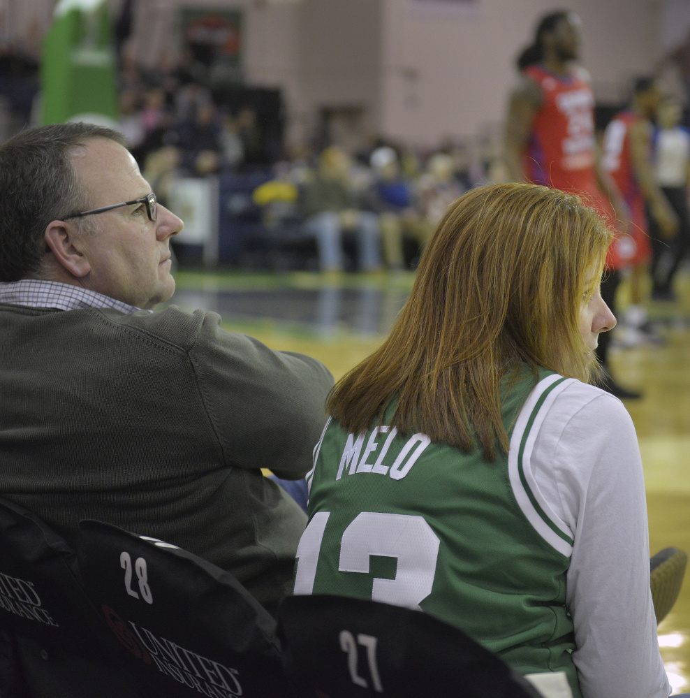 "Stacey Ryan sports a Flo Melo Boston Celtics jersey while attending the Red Claws game with her husband, Bill Ryan Jr. The team owner, Ryan Jr. remembers Fab Melo, who died Saturday, ""always had a smile on his face."""