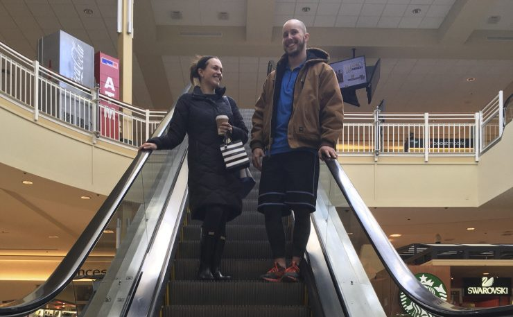 Courtney Taylor and her boyfriend, Zach Tobias, shop at a mall in Whitehall, Pa. They don't mix shopping with politics, but say it seems to be happening more often during the Trump era as activists who oppose or support the president target stores and brands for boycotts.
