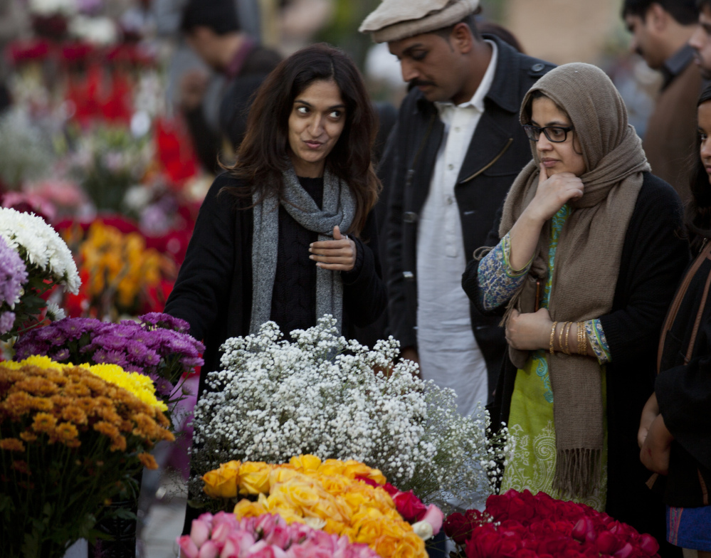 People buy flowers to celebrate Valentine's Day in Islamabad, Pakistan, on Monday. A Pakistani judge has banned Valentine's Day celebrations in the country's capital.