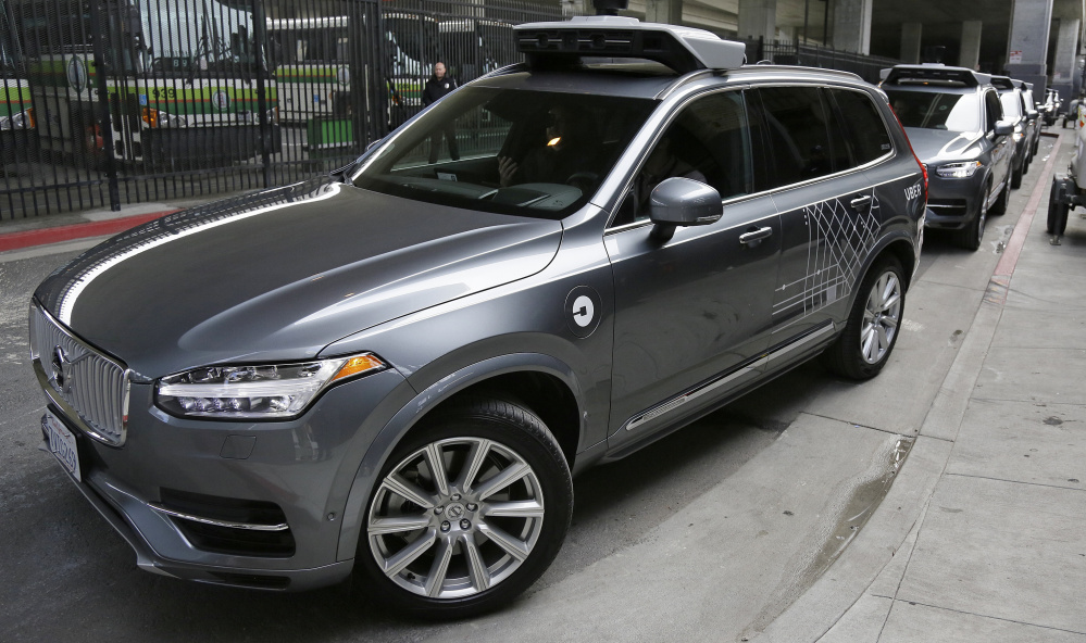 An Uber driverless car heads out for a test drive in San Francisco. Some people may first experience a self-driving car by using an on-demand ride-sharing service like Uber.