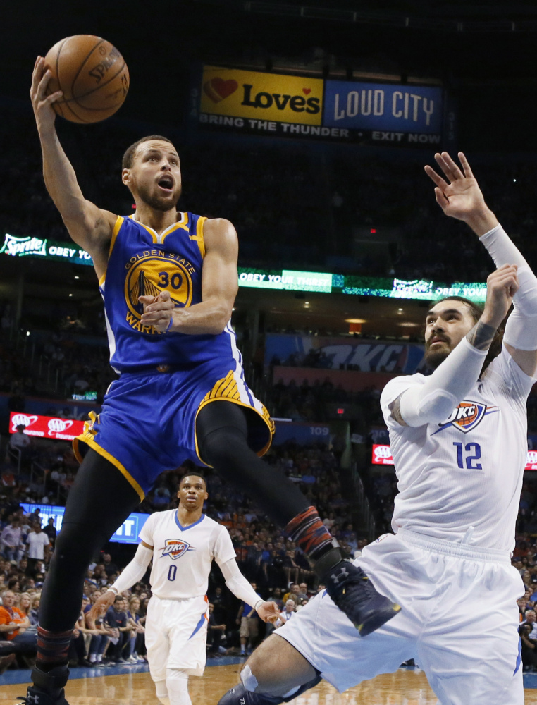 "Golden State's Stephen Curry soars past Oklahoma City's Steven Adams during a 130-114 win on Feb. 11. Curry's scoring average is down with Kevin Durant on the team, but ""we are about winning,"" he said."