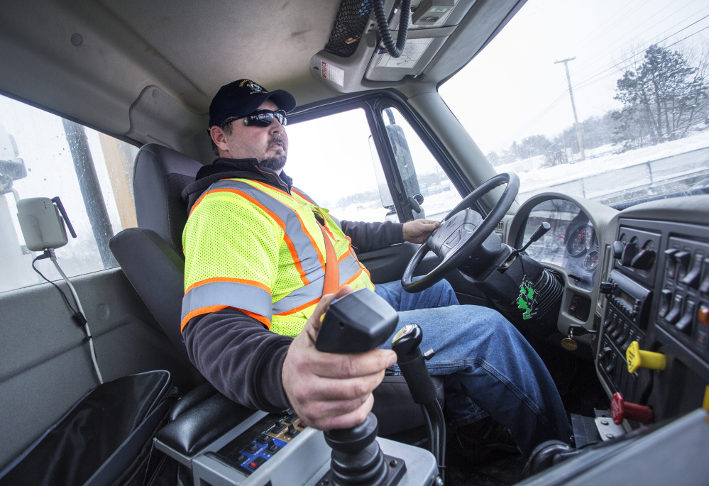 Gary Pelletier of the Maine Department of Transportation drives a snowplow truck Monday on Interstate 295 in Portland. The transportation department is working to solve a driver shortage in Cumberland and York counties.