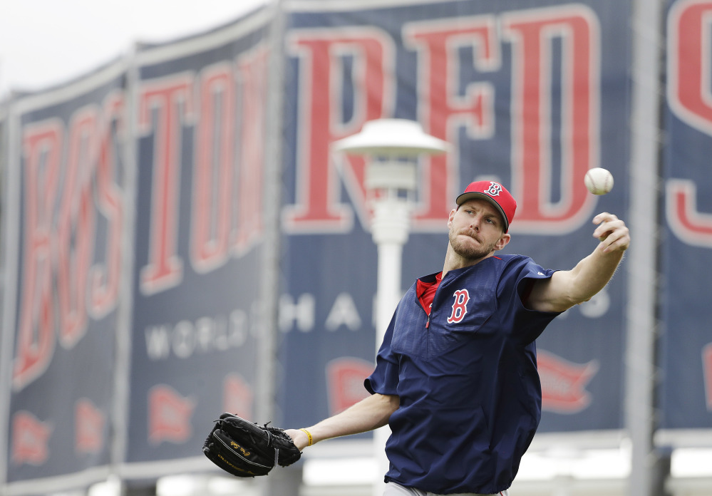 Red Sox pitcher Chris Sale throws during a spring training workout Monday in Fort Myers, Fla. One question is whether he will follow other big-name pitchers' tendency to fall short of expectations in their first season in Boston.