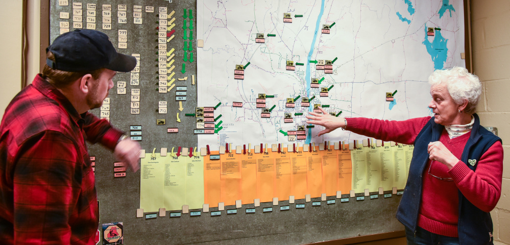 Jerry Dostie, left, Augusta street superintendent, reviews the city's snow operations map with Public Works Director Lesley Jones during Monday's storm. The map tracks 21 plow routes in Augusta and the drivers assigned to each.