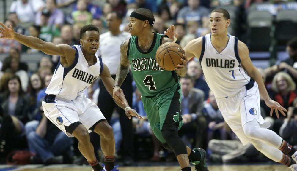 Celtics guard Isaiah Thomas dribbles against Mavericks defenders Yogi Ferrell (11) and Dwight Powell in the first half. Thomas finished with 29 points and the Celtics got another win.