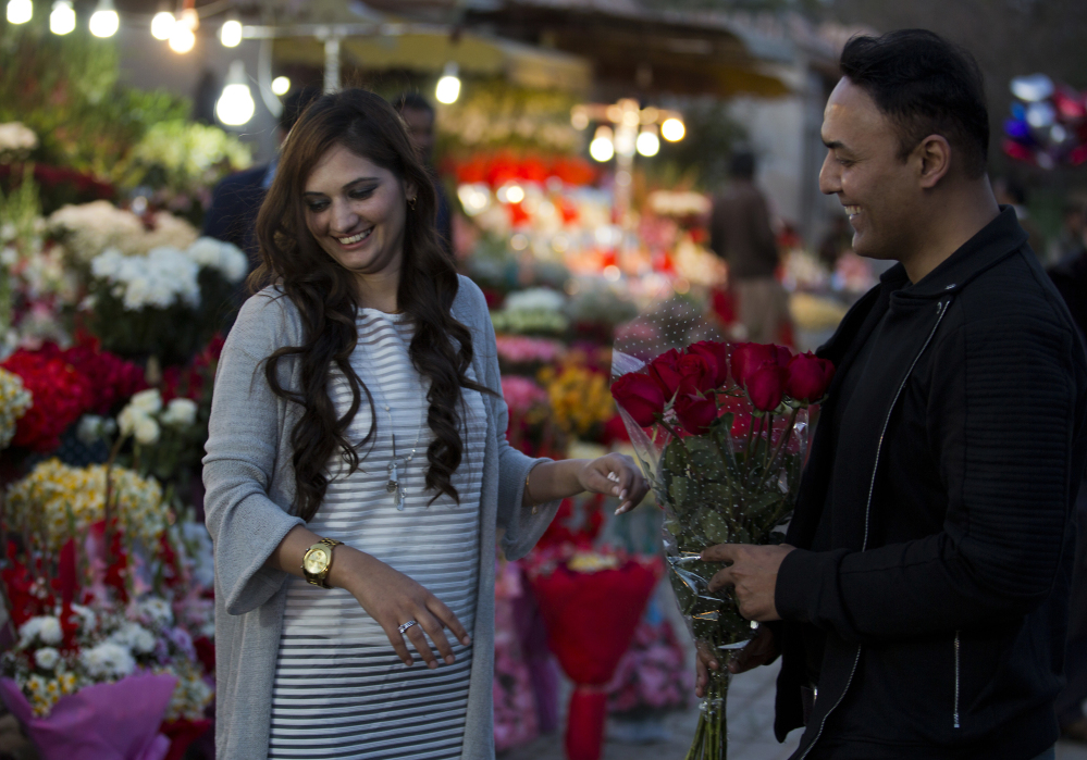 A couple buy flowers Monday in Islamabad, Pakistan. A judge banned Valentine's Day celebrations in the country's capital, saying they are against Islamic teachings.