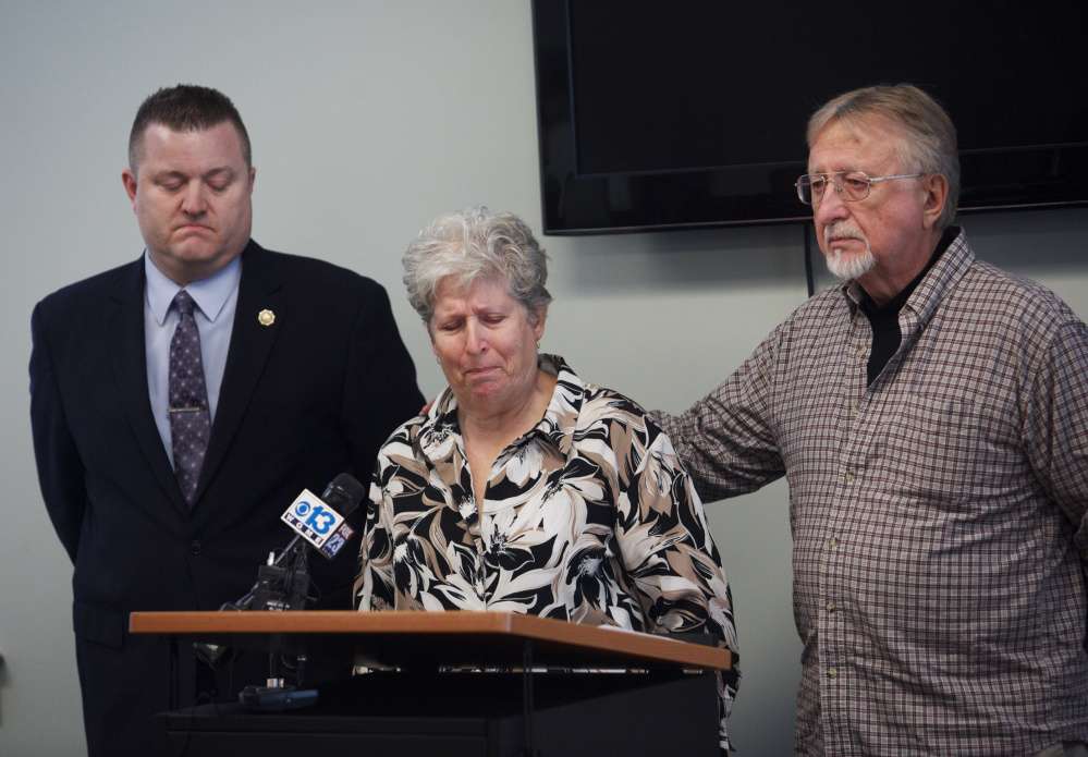 Sanford police Detective Eric Small, left, listens as Kenneth and Sheila Rear make a public plea for information regarding their missing daughter Kerry Rear, who was last seen on Jan. 22 in Sanford.