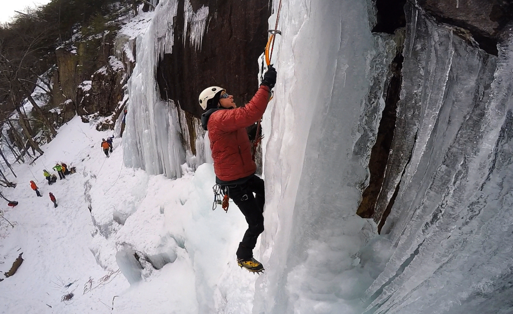 "Chuck Monjak of Dedham, Mass., climbs an ice formation on Frankenstein Cliff in Hart's Location, N.H., on Feb. 6. ""It's definitely terrifying on some level. I think that's why a lot of us do it, because of the adrenaline rush,"" Monjak said."