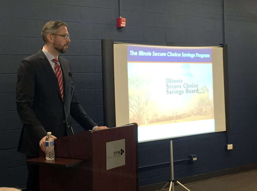Illinois Treasurer Michael Frerichs talks to small-business owners about Secure Choice IRA, a state-sponsored retirement savings plan, in Schaumburg, Ill.