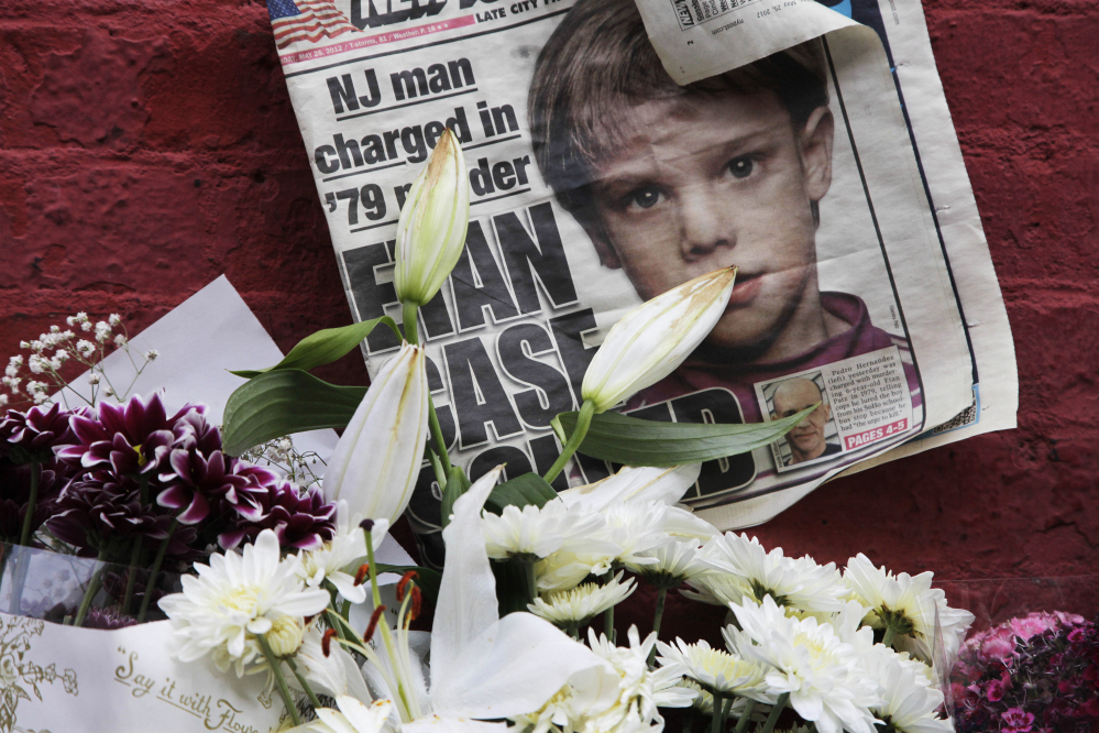 A newspaper is part of a makeshift memorial to Etan Patz in New York City. The anniversary of his disappearance has been designated National Missing Children's Day.