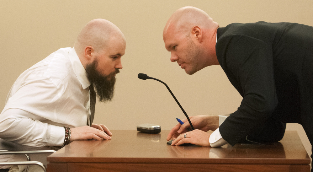 Leroy Smith III, left, confers with defense attorney Scott Hess in January during a hearing on Smith's mental competence to be tried for murder, in connection with the slaying and dismembering of his father in May 2014.