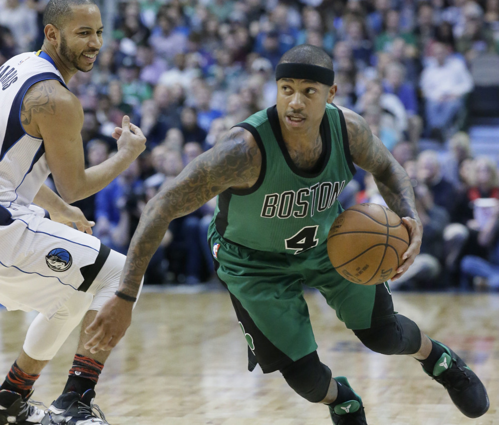Isaiah Thomas, driving past Devin Harris of the Dallas Mavericks during the second half Monday night, says the Boston Celtics are looking to keep their surge going with games Wednesday and Thursday before the All-Star break.