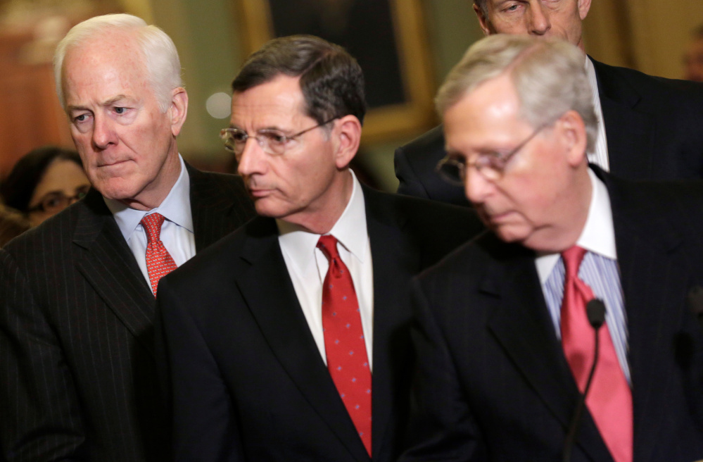From left, Republican Sens. John Cornyn, John Barrasso and Senate Majority Leader Mitch McConnell speak Friday on the scope of the Intelligence committee's probe into Russian ties.      REUTERS