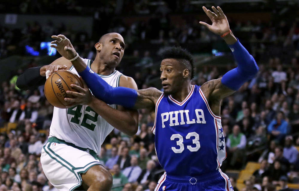 Celtics center Al Horford is blocked by Philadelphia's Robert Covington on a drive to the basket in the first quarter Wednesday night in Boston.