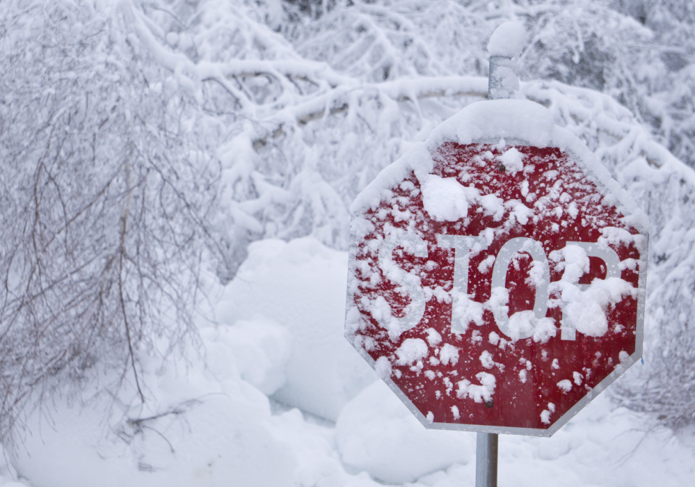 KENNEBUNK, ME - FEBRUARY 16: A stop sign in Kennebunk is coated in wet snow on Thursday morning, February 16, 2016. Stop is what many Mainers may be thinking this morning as they wake up to another day of digging themselves out from more snow that fell overnight. (Staff Photo by Gregory Rec/Staff Photographer)
