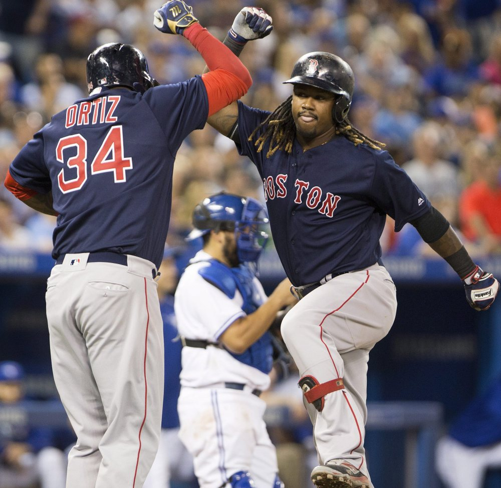 Hanley Ramirez, right, won't be sharing the clubhouse anymore with David Ortiz, yet they not only stay in contact, but Ortiz offers advice on how to approach the role of designated hitter for the Red Sox.