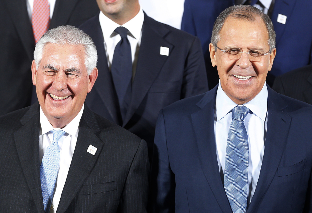 Russian Foreign Minister Sergei Lavrov, right, and Secretary of State Rex Tillerson attend the G-20 foreign ministers meeting Thursday.