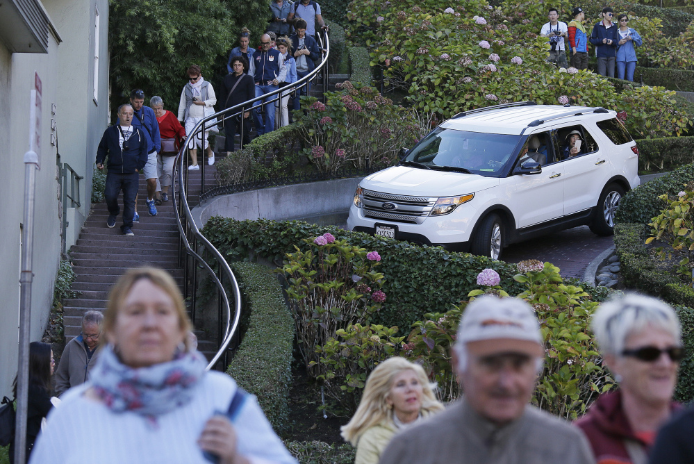 "Associated Press/Eric Risberg Tourists make their way down Lombard Street, known as the ""most crooked street"" in San Francisco. A San Francisco supervisor is calling for a toll on the street."