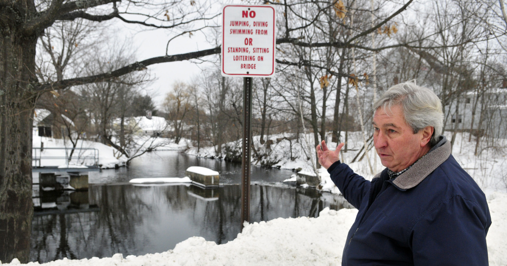 Tom Heiss talks about construction plans Wednesday at the Maranacook dam in Winthrop.
