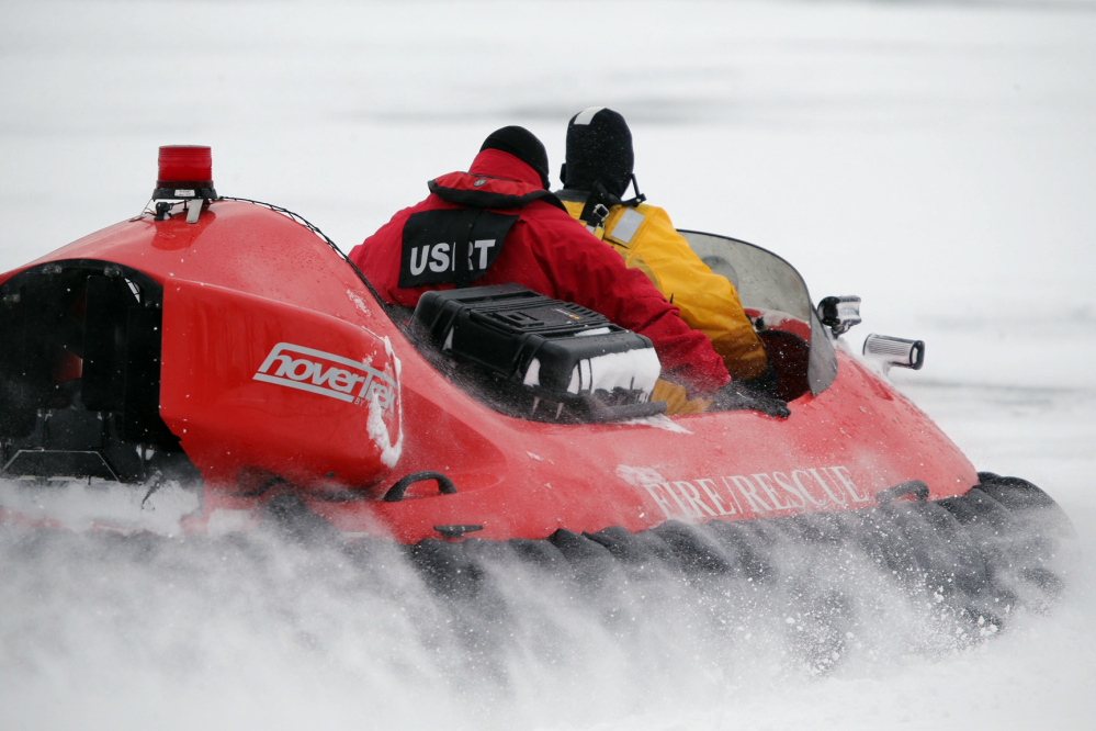 Rescue crews use a hovercraft Monday to search the frigid waters of Conesus Lake in Livonia, N.Y., for two missing snowmobilers who were believed to have fallen through the ice. Not-so-frozen lakes have claimed the lives of 10 snowmobilers across the Northeast so far in a relatively mild winter.