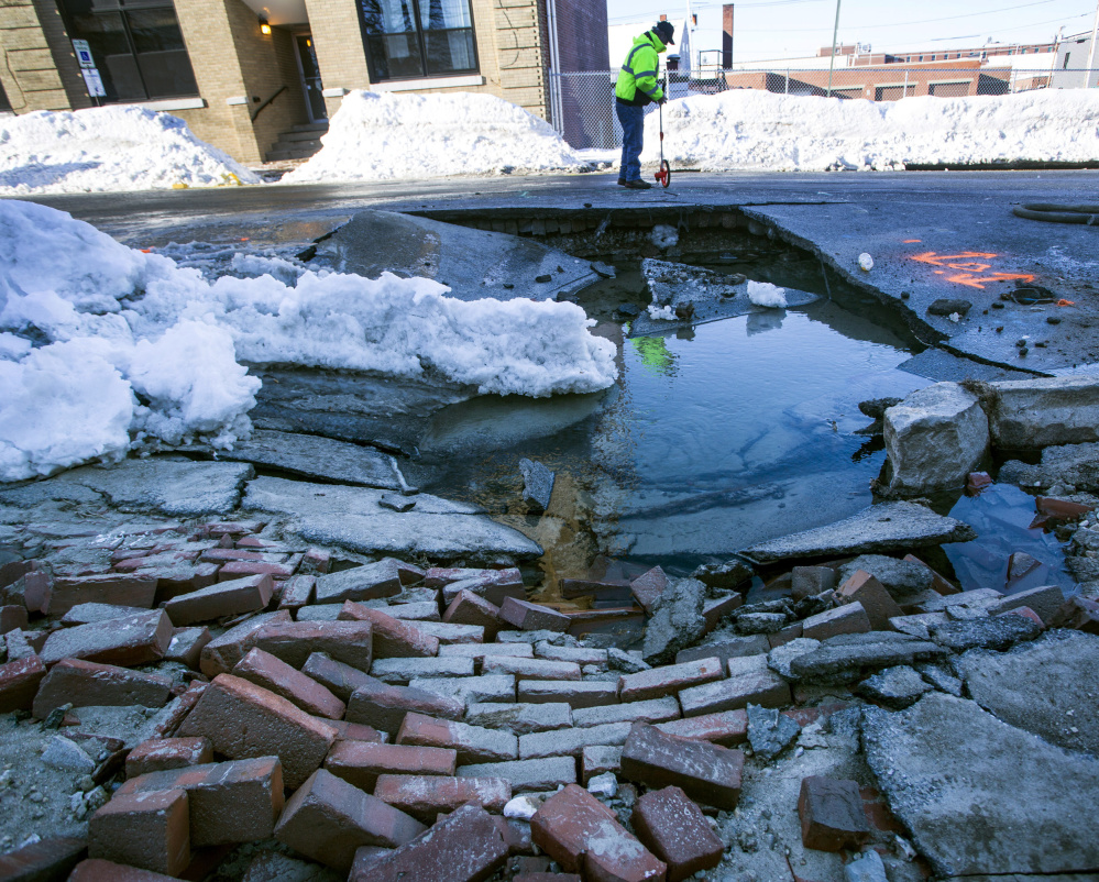 Workers on Friday said it would be hours before they got to the pipe at the center of a water main break on Preble Street in Portland. The break flooded streets and triggered a boil-water order for Munjoy Hill residents.
