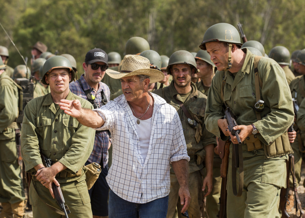 "Director Mel Gibson, center, and actor Vince Vaughn work on the set of the film ""Hacksaw Ridge."" Many thought Gibson's anti-Semitic tirade in 2006, recorded while being arrested on suspicion of drunken driving, was the end to his stardom."