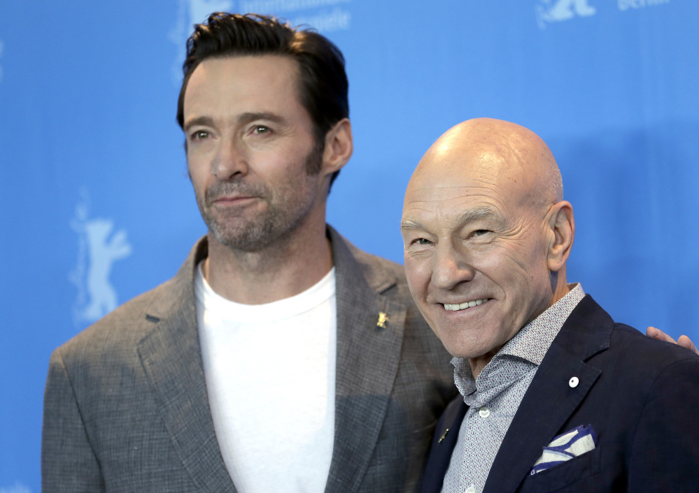 "Actors Hugh Jackman, left, and Patrick Stewart pose for photographers during a photo op for the film ""Logan"" at the 2017 Berlin Film Festival in Berlin, Germany, on Friday."