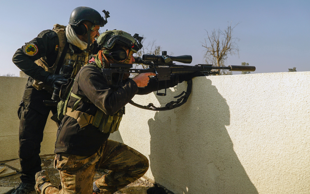 Iraqi special forces soldiers scan for Islamic State fighters on the eastern side of Mosul, Iraq, last month. The fighting is taking a financial toll on the terrorist group.