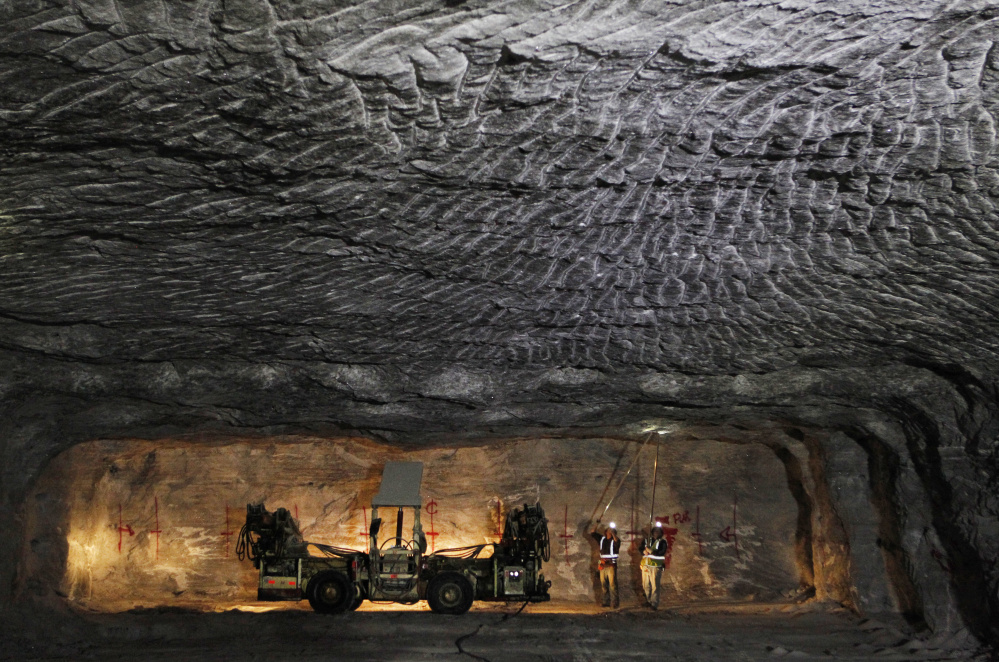 American Rock Salt Co. workers use hand scalers to remove loose roof material at the mine in Hampton Corners, N.Y. American, which employs 350 workers, can produce up to 4.3 million tons of road salt each year. Miners can earn more than $80,000 with overtime in a busy winter. But