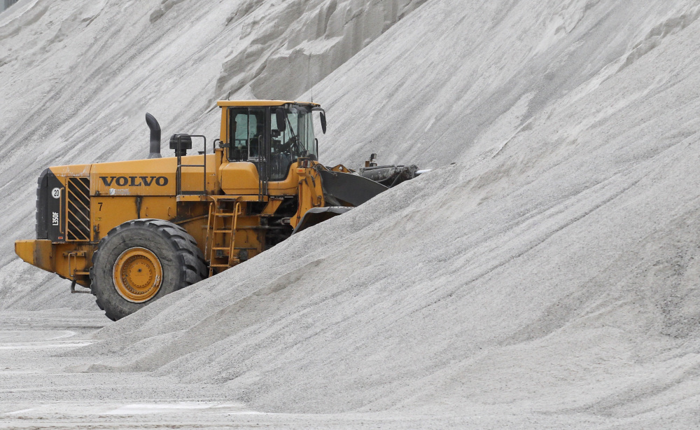 An American Rock Salt Co. loader works a salt pile at the mine in Hampton Corners, N.Y., last month. The company mines a seam of salt left from a massive sea that dried up 400 million years ago.