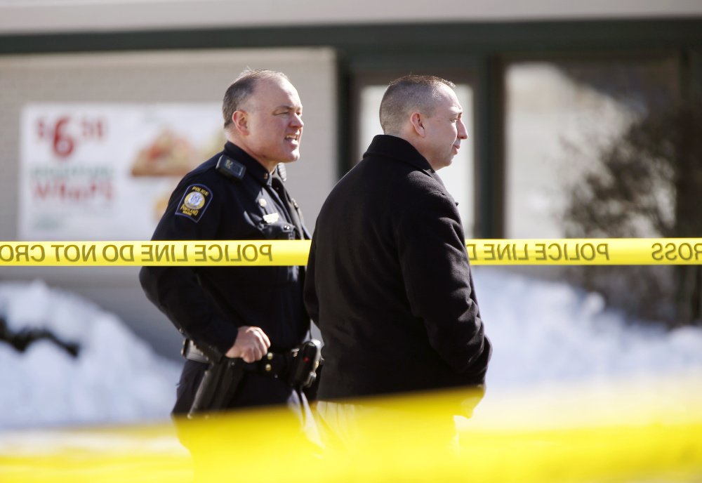 Portland Police Chief Michael Sauschuck, right, stands with another officer at the scene of a police-involved shooting outside Subway on St. John Street on Saturday.