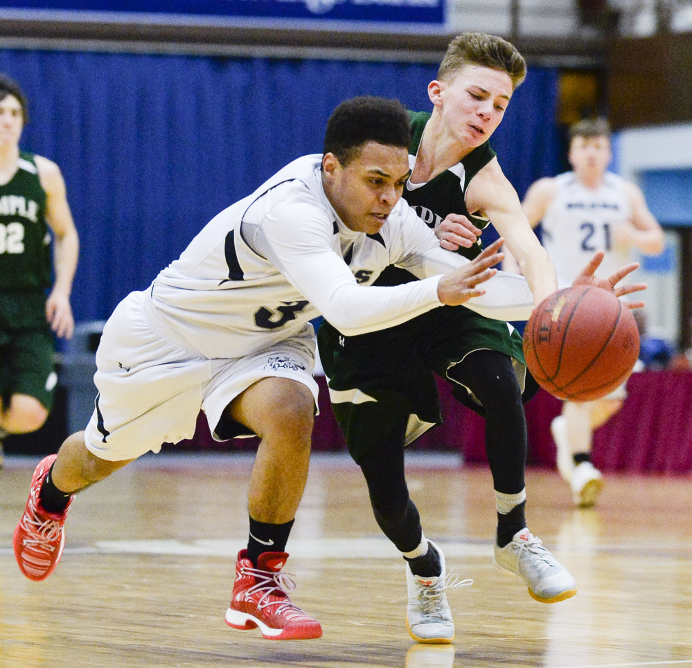 Tyrese Collins, left, of A.R. Gould races to a loose ball in front of Micah Riportella of Temple during a Class D South boys' basketball quarterfinal Saturday at the Augusta Civic Center. A.R. Gould won 76-63 and will play Vinalhaven in the semifinals.