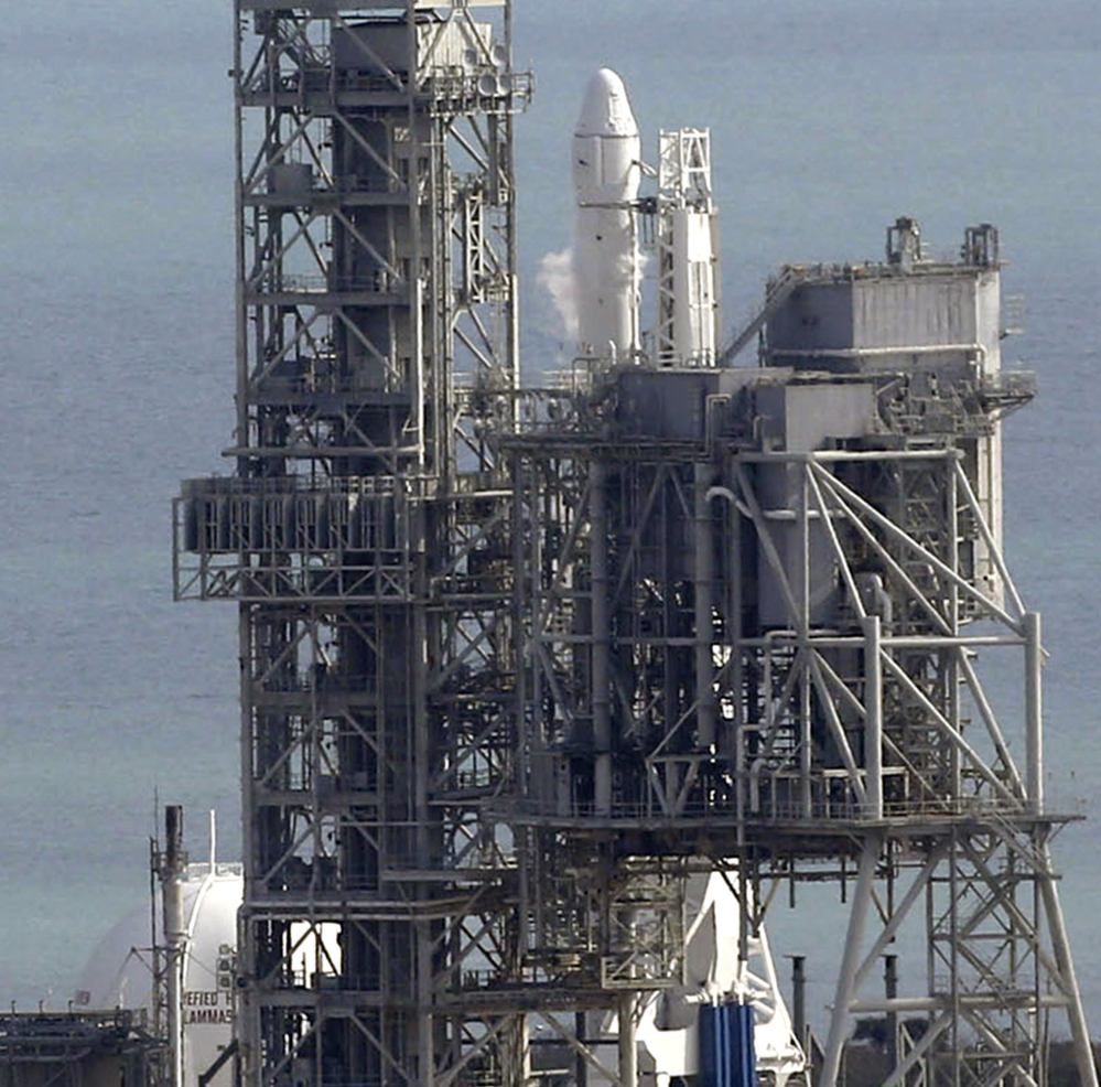 The Falcon remains at Kennedy Space Center in Cape Canaveral, Fla., where its scheduled Saturday launch had to be postponed for what was called a minor problem.